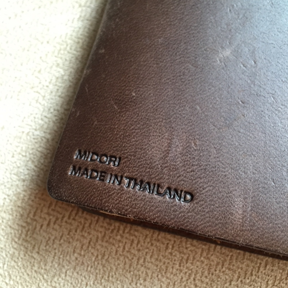 The only trace of branding on the notebook is this very modest embossment on the lower left corner of the back cover.
