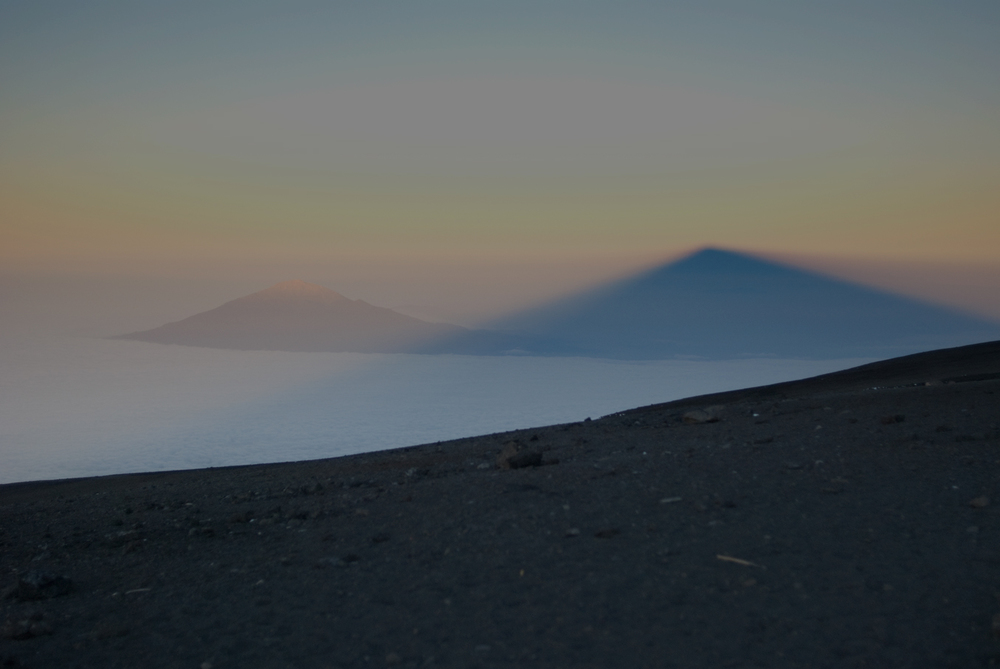 The shade of Mt. Kilimanjaro over Mt. Meru, Tanzania