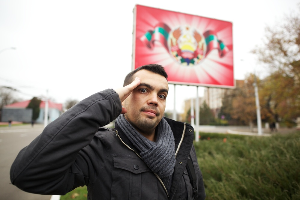 Mitko posing with the national flag of Transnistria