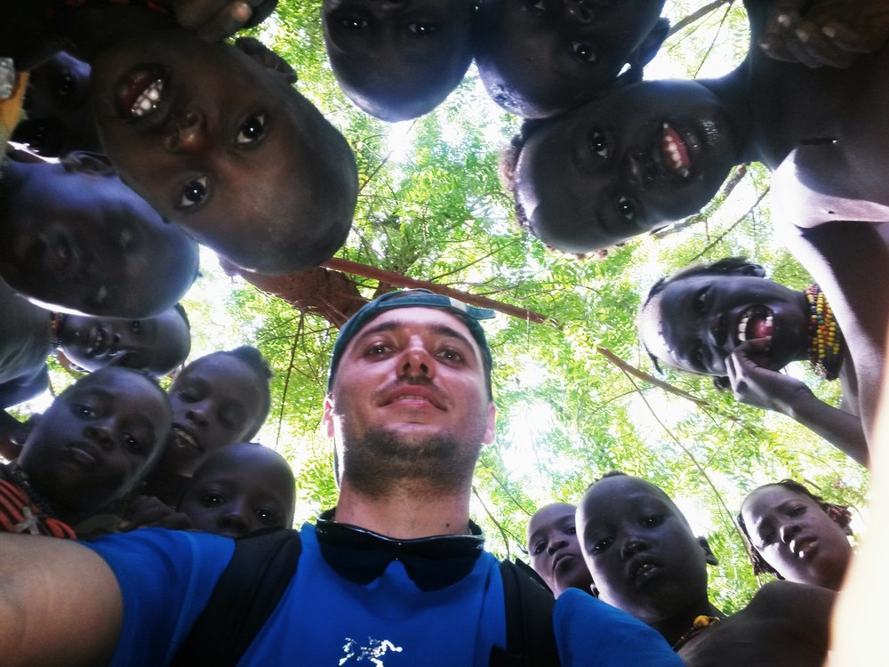 Georgi surrounded by the kids of Daasanach tribe, Lower Omo Valley, Ethiopia