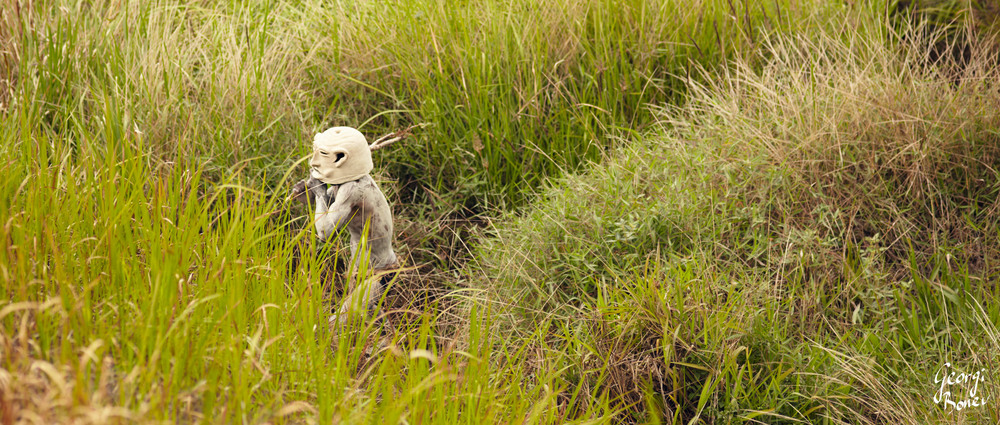 ASARO MUDMEN WALKING IN THE BUSH, PAPUA NEW GUINEA