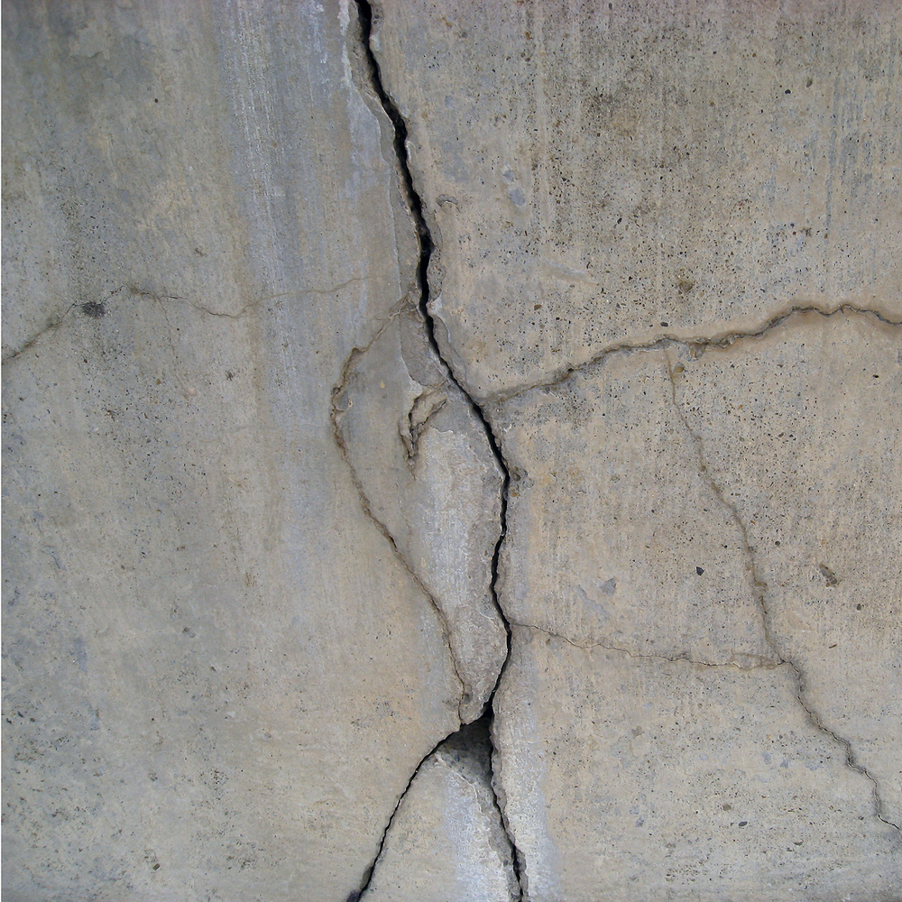 Figure 6. Structural cracks in concrete wall. Photo credit: Sherrie Thai.