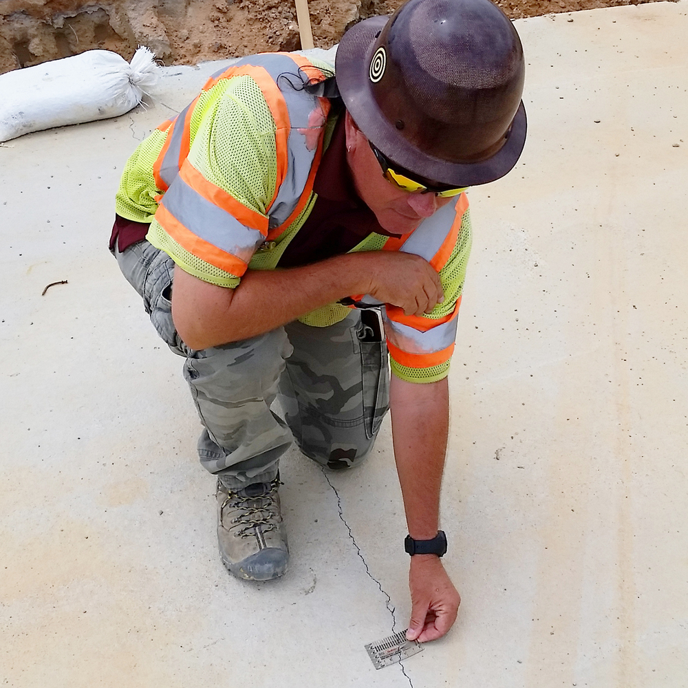 Figure 1. I-295 inspector, Michael Harper, uses the Buildera™  CRACKMON ® 224R Crack-Width Comparator to measure settlement cracks on a roof culvert of the Fayetteville Outer Loop