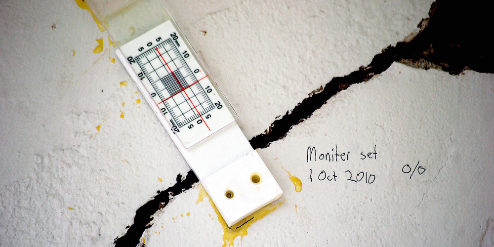 Crack monitor detects changes in crack displacement of plaster wall. Photo © Paul Sullivan.