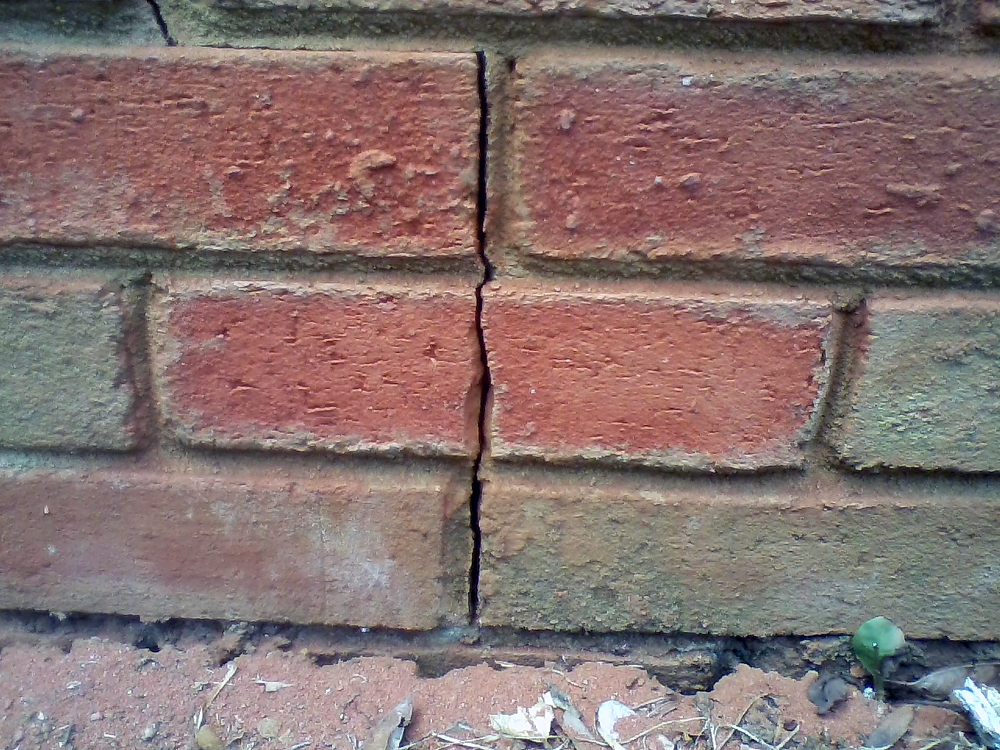 FIGURE 1. Expansion cracks from clayey soil is a likely culprit of veneer cracks.