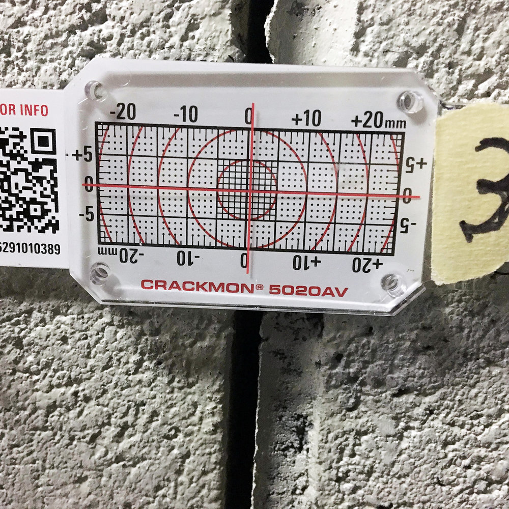 Figure 4. Buildera CRACKMON 5020AV measures new lateral displacement on basement wall approaching 1 mm.