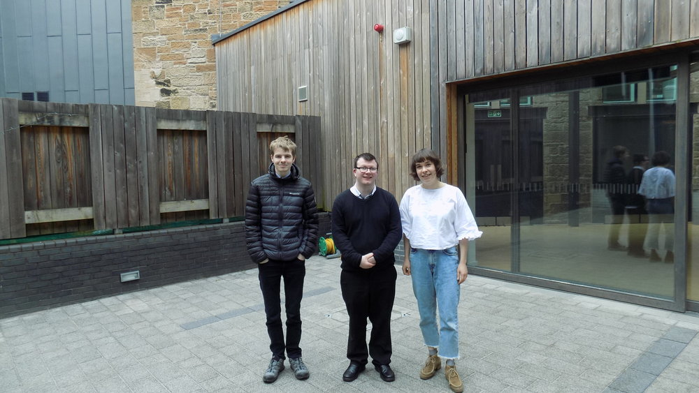Ruairi, Marc and Anna in the Halls courtyard.