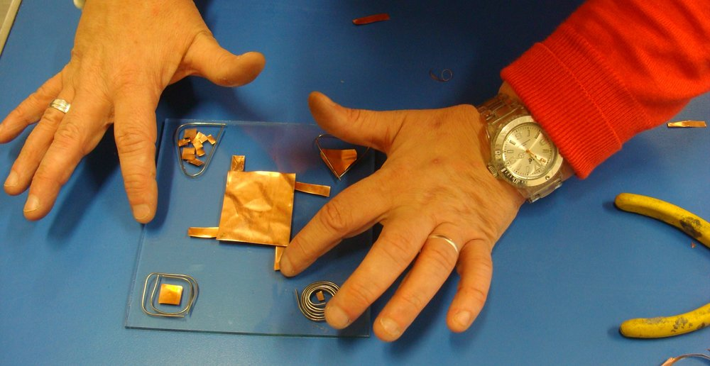 Hands at Stained Glass Workshop.jpg