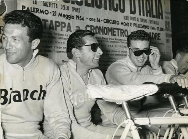 gibier3000: Ettore Milano and Fausto Coppi, during la punzonatura (the first day where officials check licencies and riders get their number) of the 1954 Giro. Milano married Ada Cavanna, the daughter of Biagio Cavanna, the campionissimo's famous blind masseur.