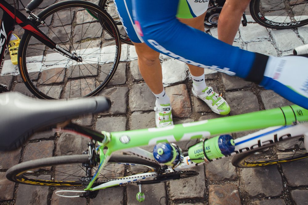 emilymaye :     legs, cobbles, cigarette. paris-roubaix, 2012.     One for @demdeez