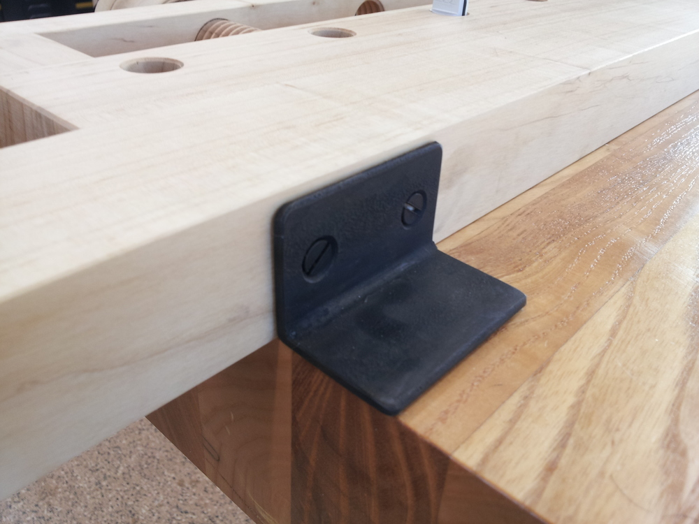 Flippable hold-downs and round bench dogs make a versatile bench