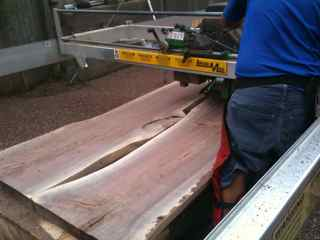 planing two walnut slabs