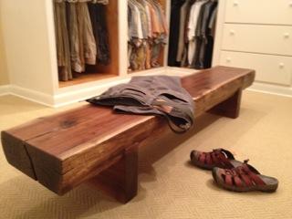 walk in closet with walnut bench