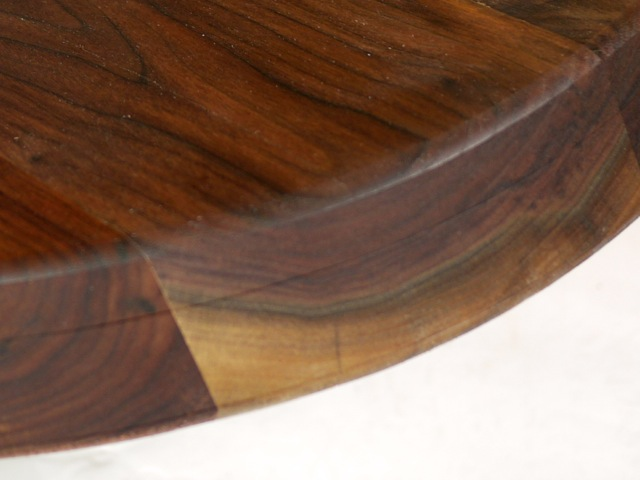 "close up of 3"" thick oval solid walnut top"