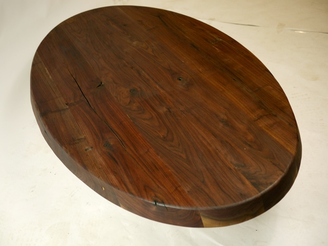 Unfinished oval walnut top, appearing somewhat finished for this pic.