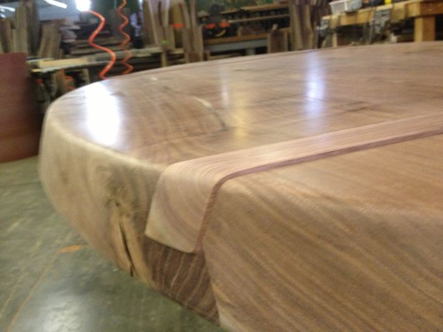 "3"" thick elliptical walnut top closeup."