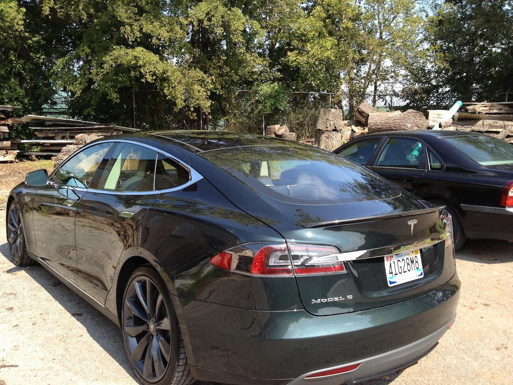 "Linda's 12 year old Volvo still looking pretty darn good beside this new Tesla ""something"""