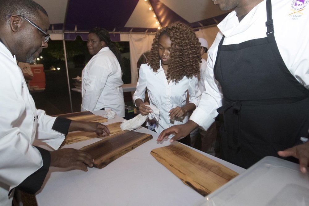 UNA under lights 2016 serving boards