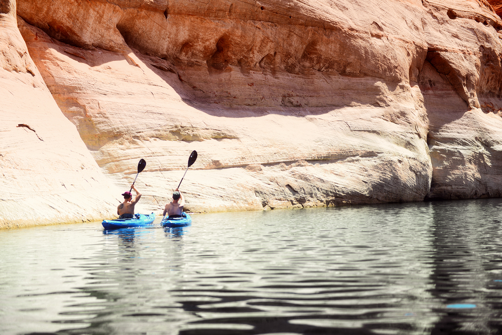 Alex and Zak in a moment of synchronicity as they enter the waters of Lower Antelope Canyon.