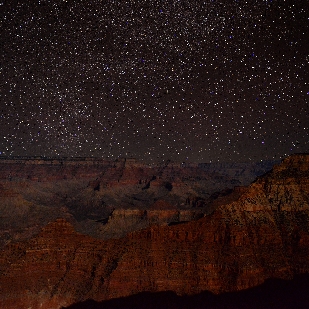 Stars shine brightly above the crimson stone of the Grand Canyon. This was taken on my first, whirlwind 5-day trip in November 2014.