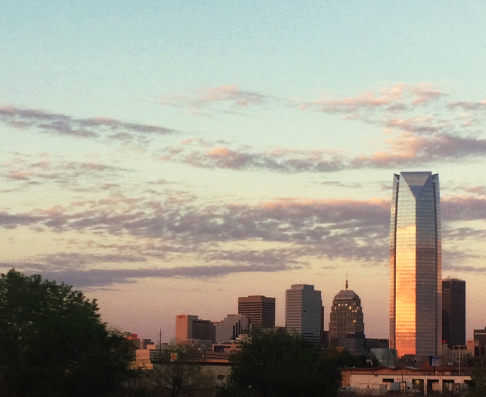 We passed through Oklahoma city just as the sun was setting. This is downtown as seen from Shadowfaxx (my white Toyota Camry aka The Beast) on I-40.