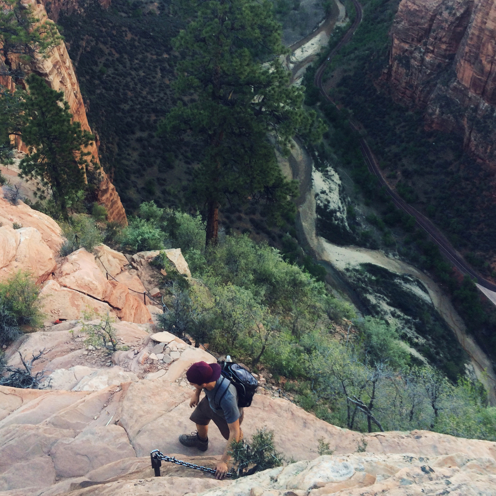 Alex navigates the very narrow ascending path to Angels Landing. The river can be seen over 1000 ft. below.