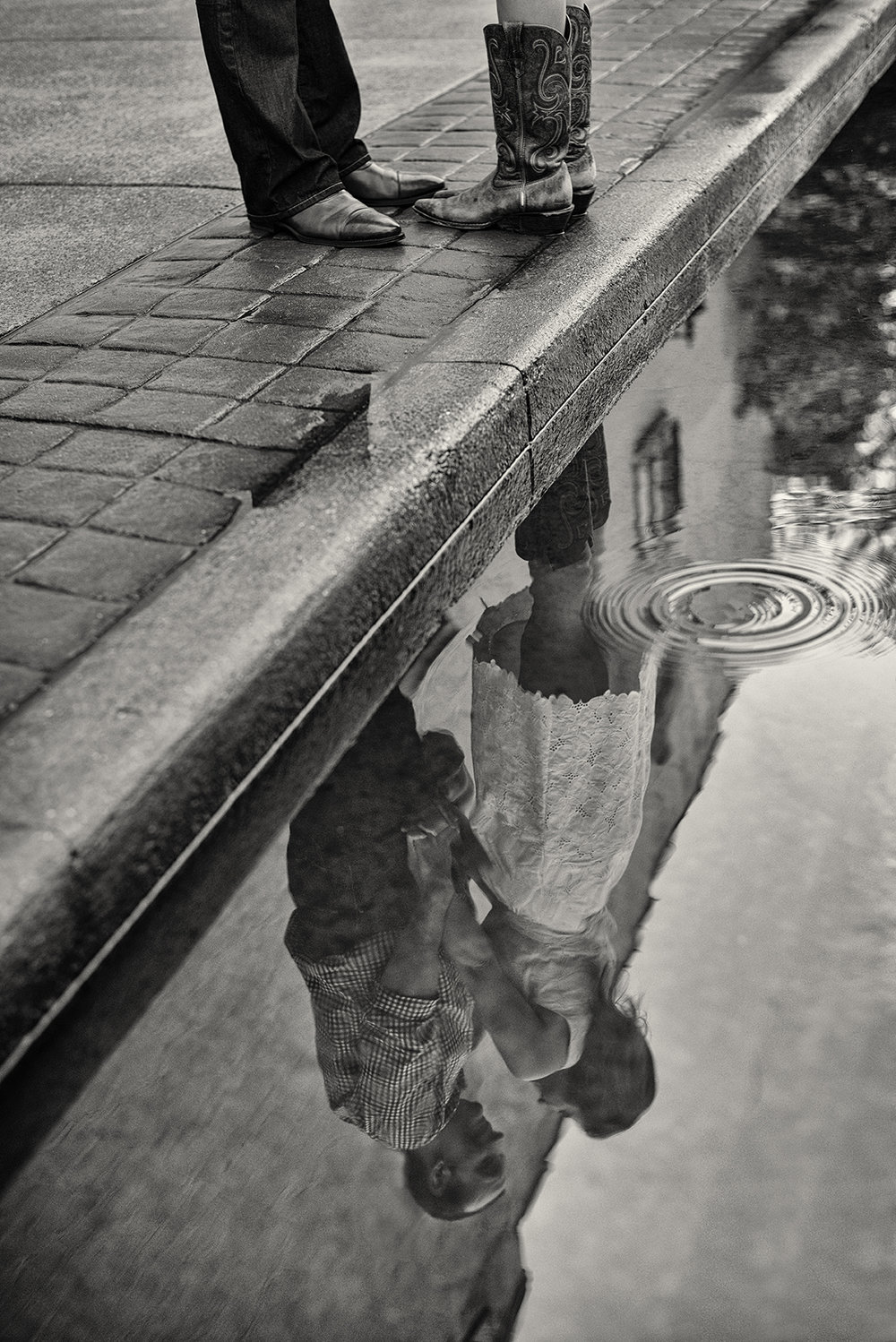 Hannah-Waylon-Downtown-Franklin-Rain-Puddle-Reflection-Engagement