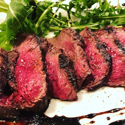 Ezo venison steak with wild rocket and balsamic sauce