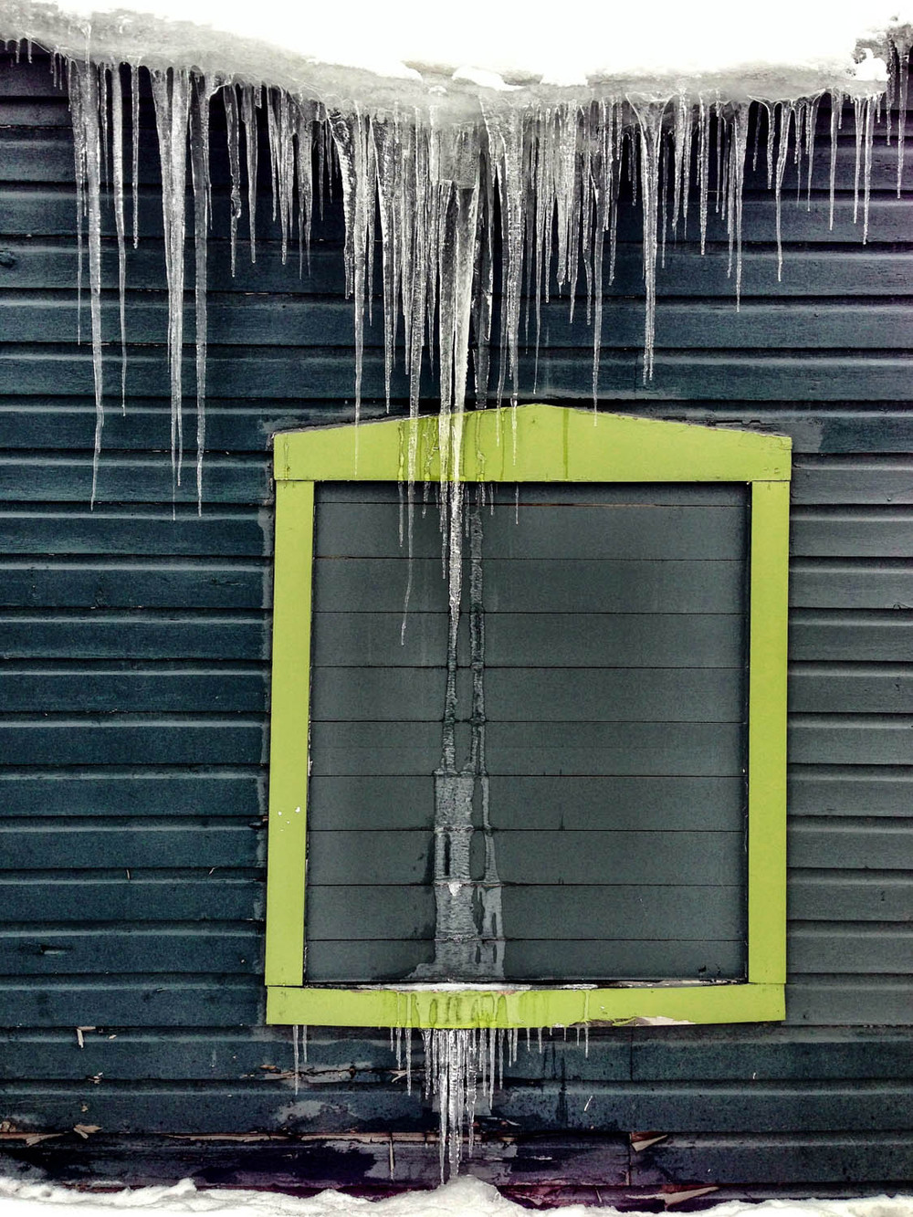 Here is a great example of the icicles that were present on the side of so many of the rooftops. I also really enjoy the contrast of color between the wall and the faux window frame.