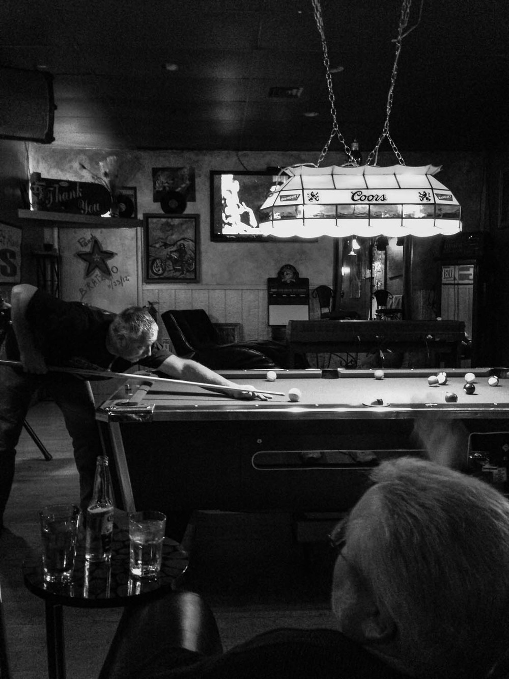 At the bottom of the mountain, there is a cafe / bar called Route 6 that had great food and a pool table. The light over the pool table provided great spotlighting for this shot.