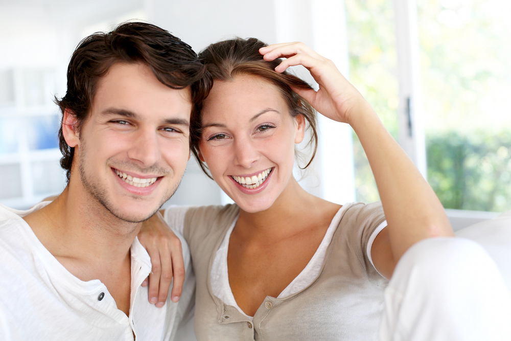 Young Couple Smiling.jpg