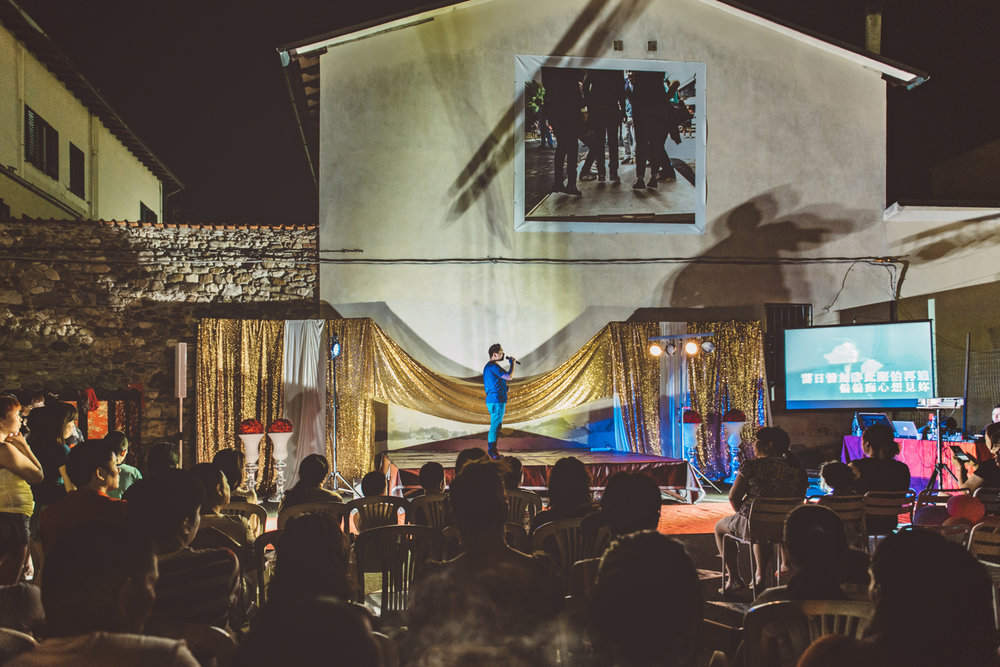 Prato, June 2016. A man sings at a karaoke contest during a musical event in the local Chinatown.