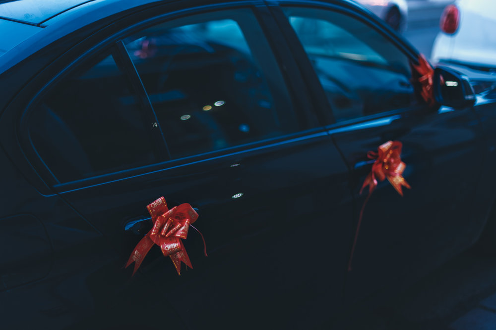 Prato, Novembre 2016. A car with well-wishing red ribbons after a Chinese wedding.