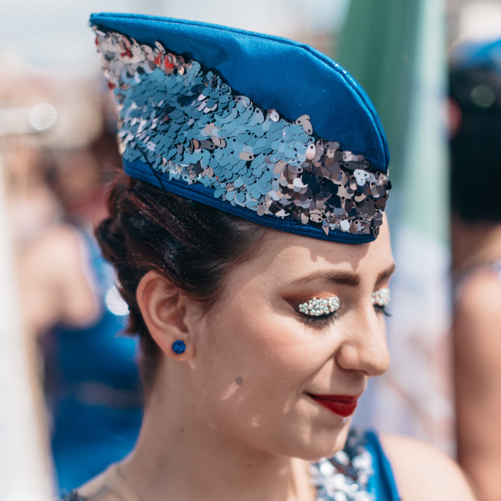 Some elaborate parade make-up on the eyelids of a young member of the Starlight Ferentum team, from Viterbo.