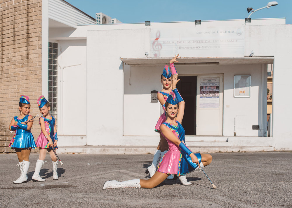 Seniors and cadets from the Majorettes di Casperia rehearsing their moves in Faleria, ahead of their performance.