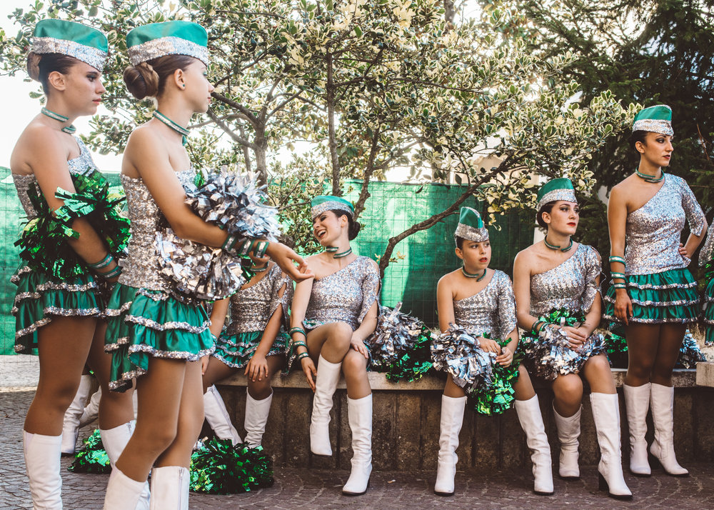 The Majorettes Compatrum team relaxing after a performance.