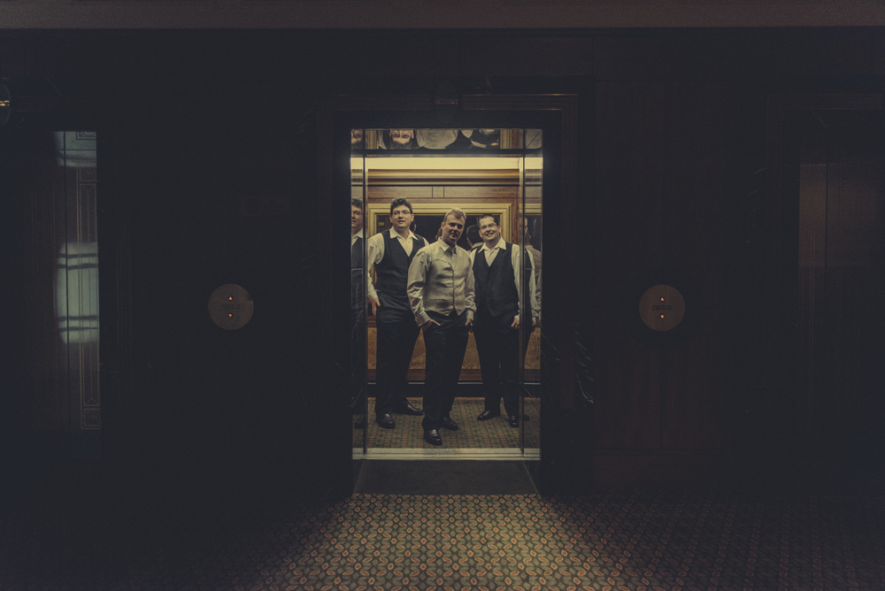 groomsmen in elevator     brisbane wedding photography     fuschia photography