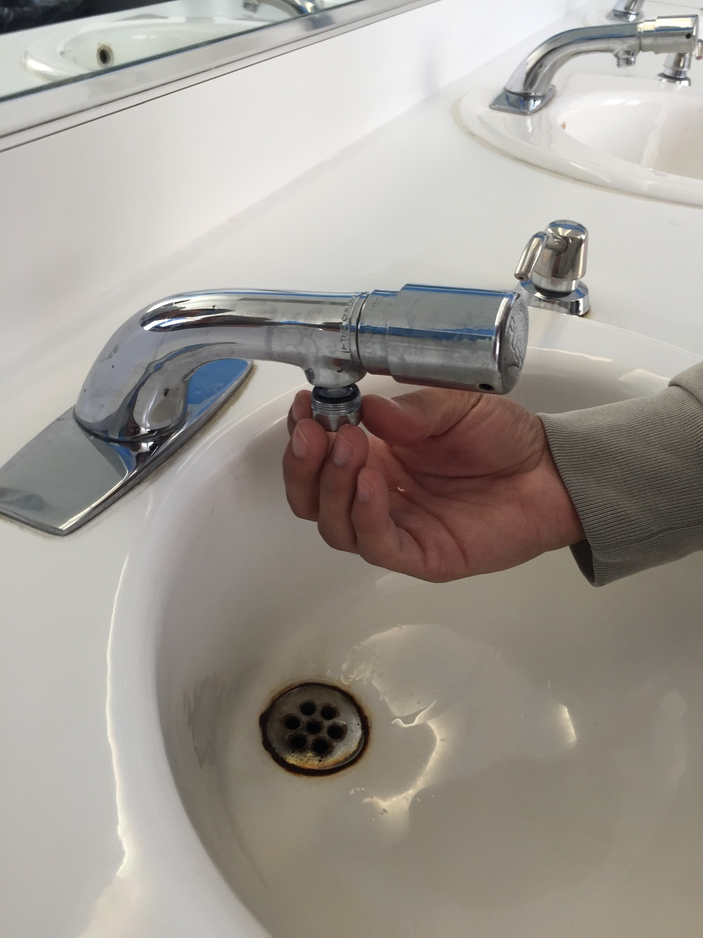 GAP Volunteers replacing low-flow faucet aerators on a project. Photo credit Josh Dean