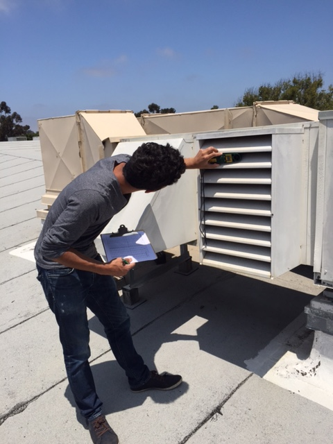 GAP Volunteer Carlo Rivera taking outdoor air delivery readings for ventilations calculations. Photo credit Josh Dean.