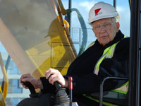 Alan Reece at the controls of a digger during the construction of The Alan Reece Building in 2009 at the University of Cambridge, Institute for Manufacturing.