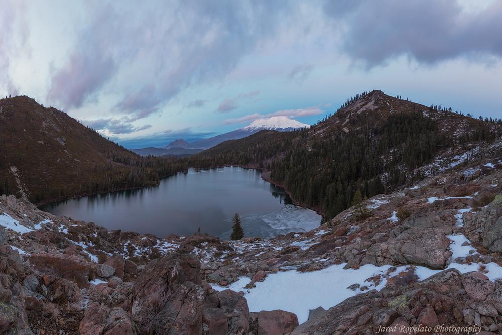 Castle Lake still mostly unfrozen just after sunset.