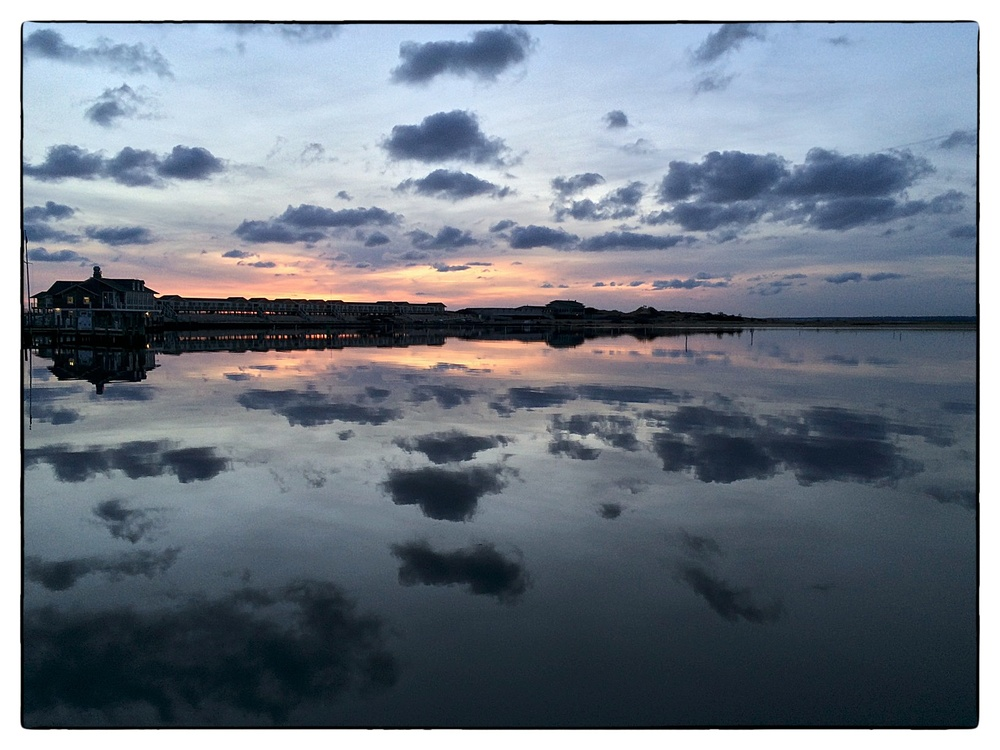 Sunset and clouds reflect on Little Narragansett Bay in Watch Hill, Westerly, R.I., shot on November 30, 2013.