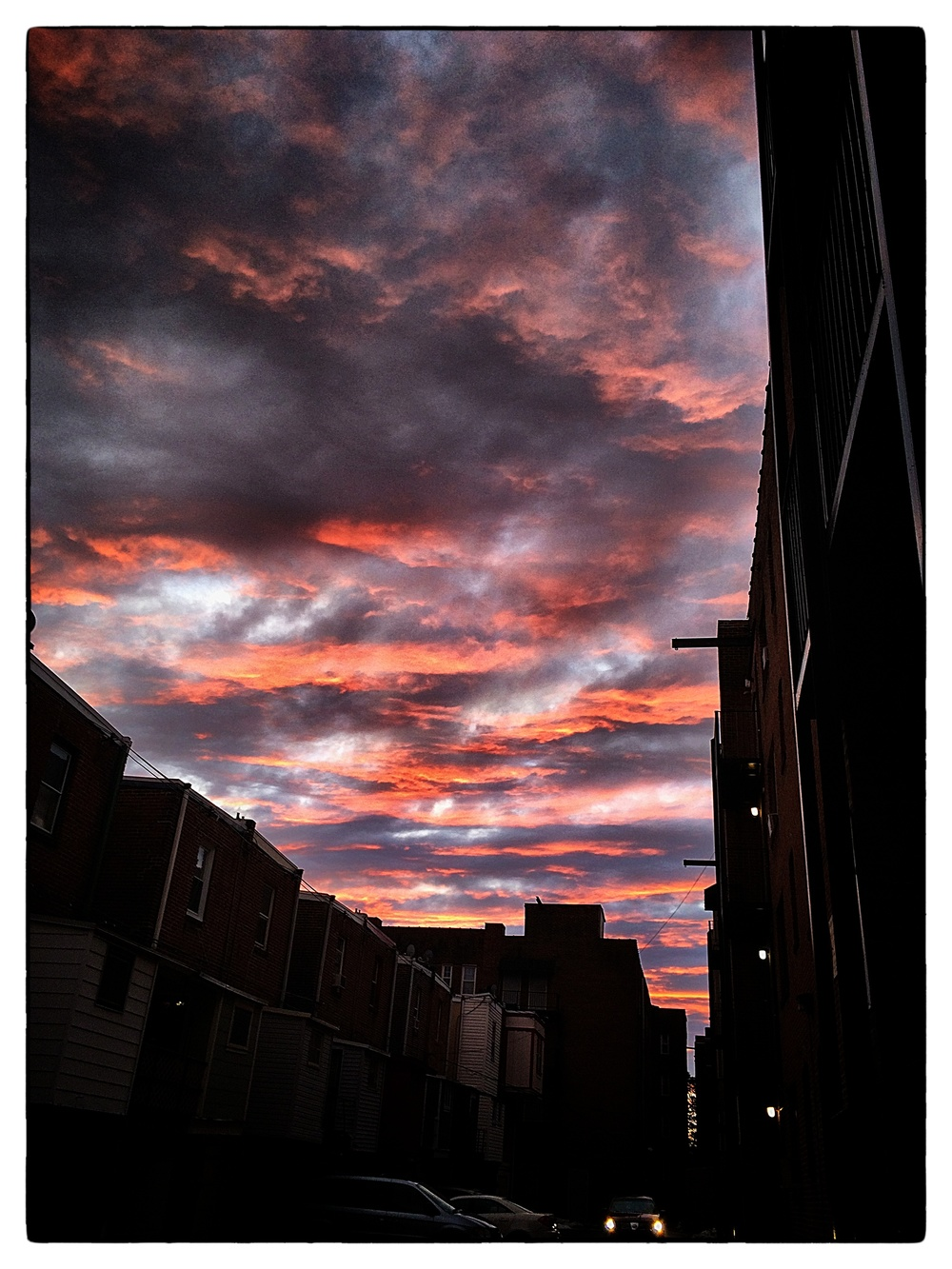 Sunset over back alley, shot February 21, 2014, in Philadelphia.