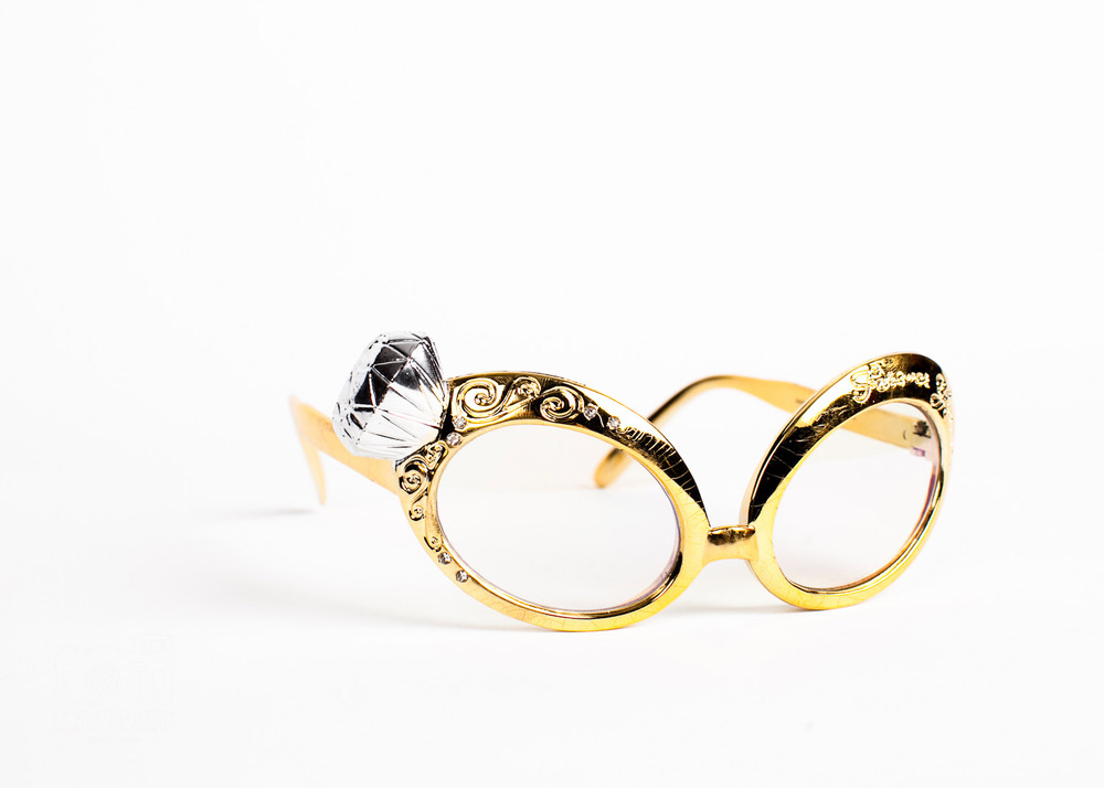 gold glasses with a diamond ring