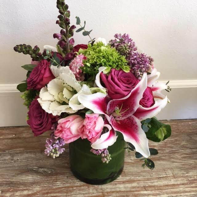 $90 arrangement in a glass vase (leaf-lined)