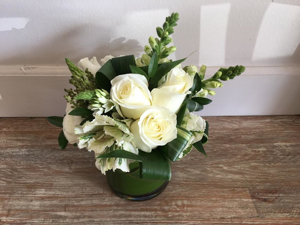 $50 arrangement in a glass vase (leaf-lined)
