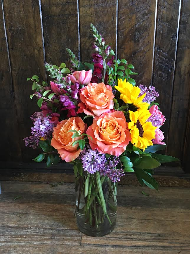 $75 arrangement in a tall, glass vase
