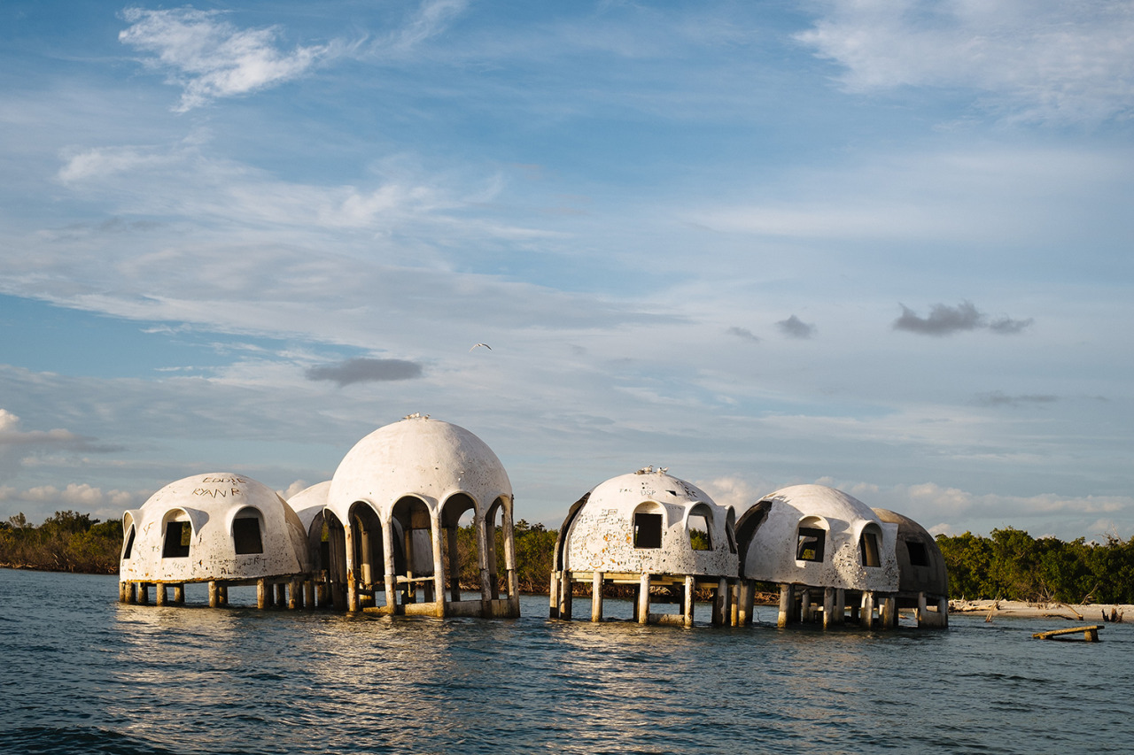 a house, once.http://www.messynessychic.com/2013/06/12/the-mysterious-dome-homes-marching-into-the-sea-before-after/