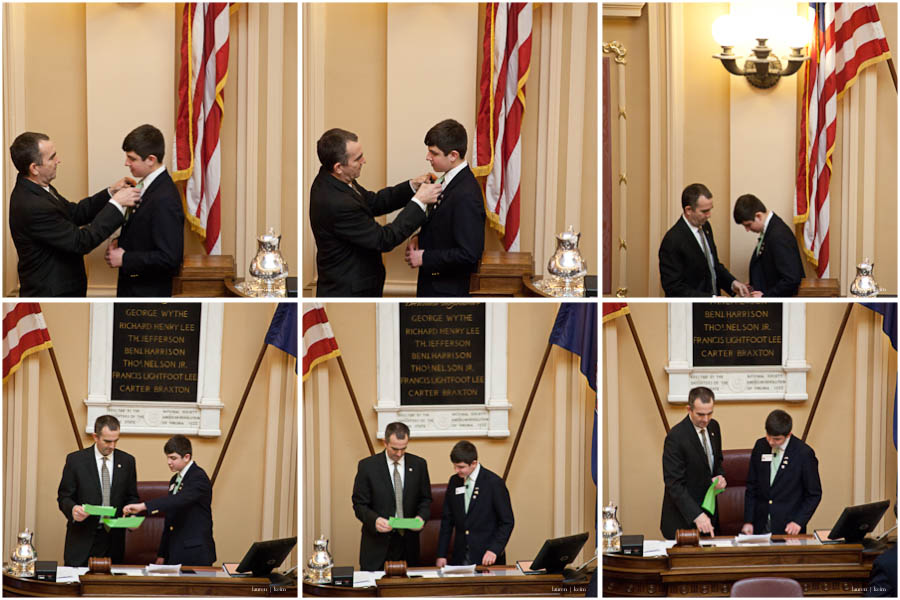 lt. governor northam helps cal get on his microphone before they go over papers at the LG's desk