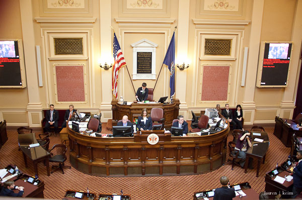 in this photo, Cal's roommate (near-center bottom right) stands to defend his bill.